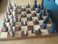 Chess set and handmade wooden board.