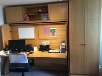 Study Bed: Office desk double bed combination. Wardrobe and over bed storage. Cost over £3000 new.