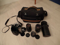 Camera lenses and Olympus OM10. These lenses will fit some digital camera's. Average condition.
