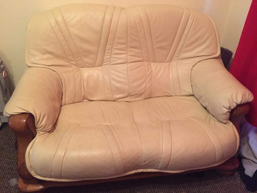 2 two seater cream leather sofas.