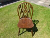 solid wheelback wooden chair with gold stud detail