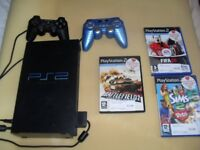 PS2 console, controllers and games