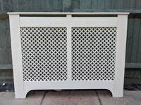 White Radiator Cover, used but good condition.