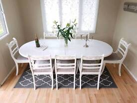 Stunning large extending dining table and 8 chairs