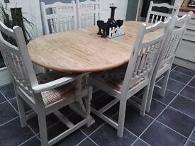 Extending table and six chairs (two carvers)