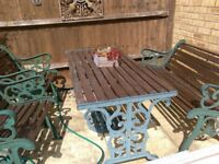 cast iron frame table 2 chairs and bench. wooden slatts