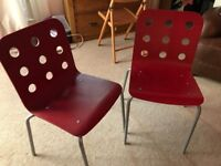 Ikea red wooden chairs