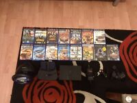 Ps2 with 15 games a steering wheel and a paddle. One controller (not checked) and a memory card 8mb