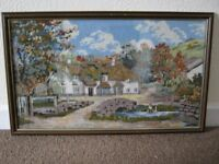 Large framed cross stitch picture of cottage and stream on Dartmoor