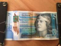 AA2 five pound note £5 money.