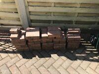 60 pink paving blocks free to collect