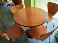 Wooden topped tables and matching chairs