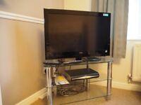 Glass shelved TV Stand