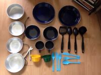 Camping cooking utensils, pans, bowls, plates, cutlery.