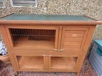 Two tiered rabbit hutch. Fair condition. New plywood flooring top and bottom.
