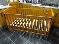 A Cot Bed in Honey Pine