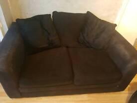 2 seater black material sofa