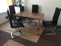 Dining table and 4 chairs. £120.00