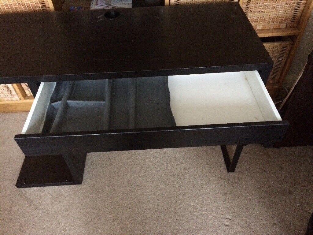 Black Ikea desk in excellent condition. Measures 120cms L x 50 cms d x 75cms h.