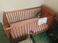 Full size pine cot.very good condition with mattress and two new flannelette sheets.
