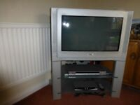 Sony TV, DVD player and freeview box with stand