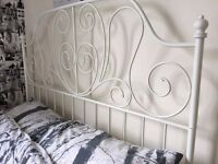 White metal frame double bed