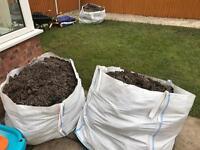 Three bulk bags full of soil for free