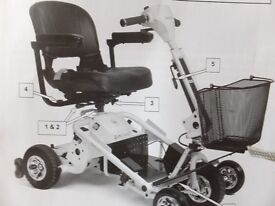 Quingo Air 2 mobility scooter with loading ramps