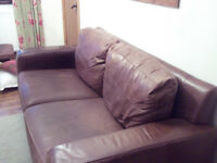 saddle effect leather sofa. 3 seater. Good condition with 1 small mark as shown.