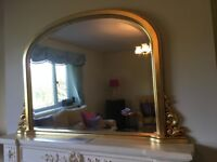 Mantle Mirror gold leaf finish with scroll design at the side.