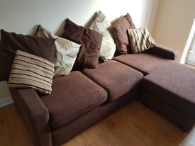 Large comfortable brown corner sofa
