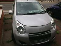 Suzuki Alto in silver 14 Plate breaking