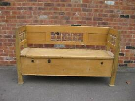Eastern European pine wooden bench with storage under seating area.