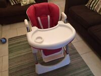 Adjustable High Chair. Reclining, height adjustable high chair. Folds up to reduce space.