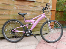 Full suspension 18 speeds Trax mountain bike in Good Condition. Women frame size M