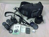 EOS Canon Rebel XT (350D) with EOS strap 8 megapixel entry-level digital single lens reflex camera