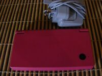 Pink Nintendo DSi with charger