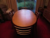 Vintage teak dining table and 4 chairs. Extending table. Perfect for restoration.
