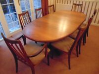 teak dining room table with 2 carver chairs and 6 other chairs pick up only from sg8 0nn