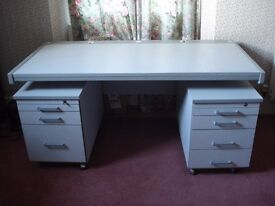 Desk with separate drawers