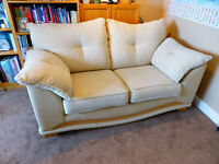 Gorgeous cream leather and fabric 2 seater sofa - hardly used.