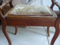 Edwardian piano stool with music storage in seat, traditional upholstery, turned side rails.