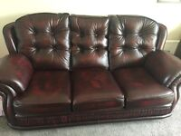 Oxblood leather 3 seater sofa with 2 armchairs for sale. Excellent condition.