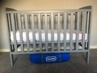 Grey cot and changing station