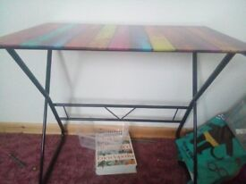 Unused glass topped multi coloured desk