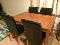 Pine Dining a Room Table an 4 Black Leather Chairs