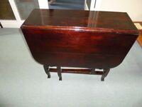 Gateleg drop leaf table in dark varnish