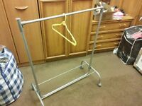 Extendable clothes hanger with wheels