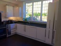 Gloss white kitchen with black granite incl dishwasher,fridge ,sink ,tap. Excl-micro, oven, hood