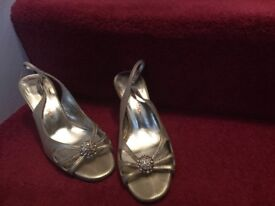 Ladies slingback gold shoes